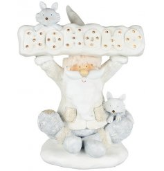 Add some music and lights to your White Winter Wonderland decor theme this year with this quirky resin santa figure