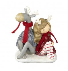 A sweet little sitting girl and reindeer friend are a great resin piece to add to any themed display this christmas