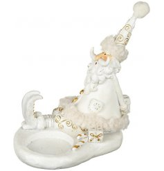 A stylish little singing resin santa, complete with a sport perfect for putting a tlight candle