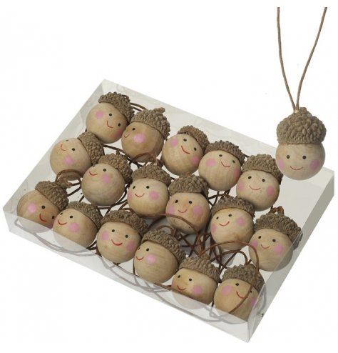 Unique wooden acorn decorations with rosy cheek painted faces. Each has an individual brown hanger.