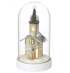 A charming LED house set within a glass dome. Complete with a snowy finish.
