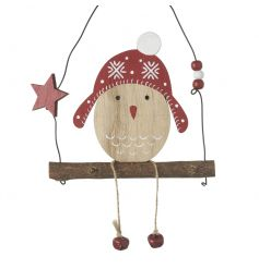 A red and natural hanging wooden robin bird decoration sat on swing.