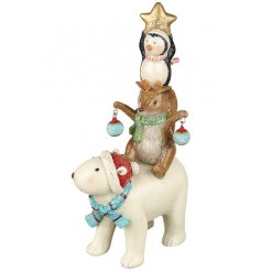 A charming polar bear standing ornament with an array of winter friends holding baubles and a joy star.
