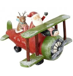 Jingle all the way with this vintage inspired red airplane with Santa and Rudolf. A much loved Christmas decoration