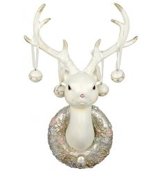 An enchanting fawn reindeer ornament with a pink glitter wreath and hanging baubles.