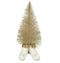 An enchanting small gold glitter tree with feet. A whimsical decoration for the Christmas season.