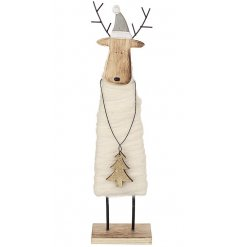 A sweet free standing reindeer wrapped in wool, complete with a small grey hat and wooden tree in his hands