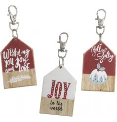 An Assortment Of Three Wooden Christmas Keyring Hangers