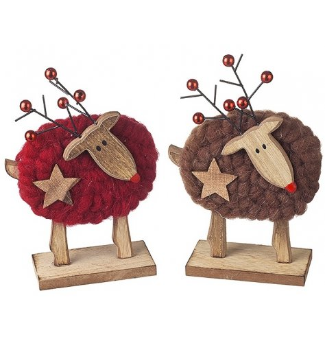 Assorted wooden reindeer decorations with red and brown woolly coats.