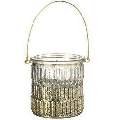A glass ridged candle pot with a gold ombre setting will add a warm glow to your home this festive period