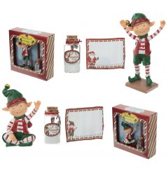 A mix of two jolly elf figures with a message to Santa and wish bottle. The perfect gift creating a magical Christmas.
