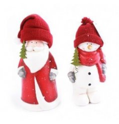 An assortment of 2 Christmas figurines with wooly hats