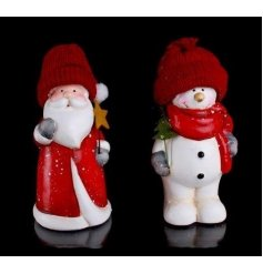 An assortment of 2 figurines in Christmas hats