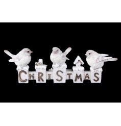 A Christmas ornament with perched robins