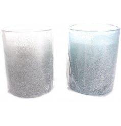 An assortment of 2 candles in glitter pots