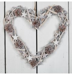 A beautiful whitewashed twig heart with pinecones and stars detail