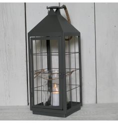 This stylish grey metal lantern will bring a simplistic edgy vibe to any home