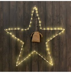 Hanging white metal star with warming LED light detail