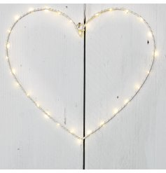 A hanging white heart decoration with warming glow LED light detail
