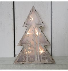 A quirky standing wooden tree with additional fitted LED lights with a sweet warming glow