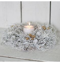 Give off that frosty feeling with this stylishly different twig candle holder, coated in a white paint and set with simp