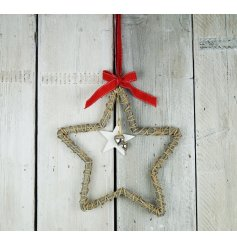A wicker star hanging decoration with bells