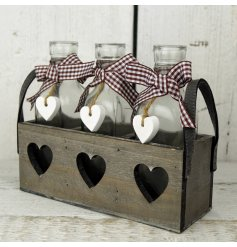 3 delicate little milk bottles sit perfectly in this natural toned heart cut tray.