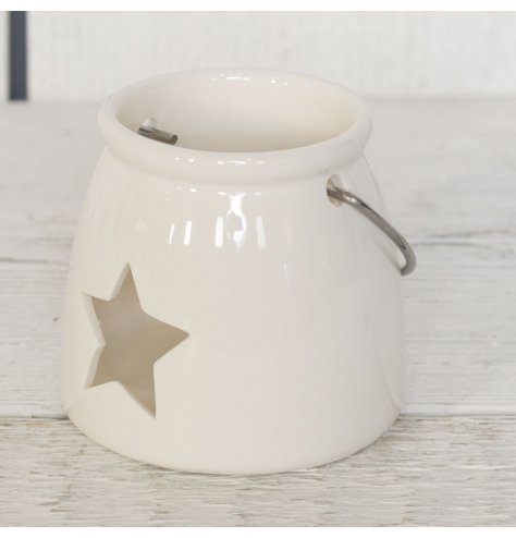 White ceramic T-light holder with star cut out. Matching lanterns also available, group together for more impact.