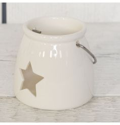 A simplistic white ceramic T-light holder complete with star detail for a delicate glow