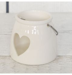 A charming white ceramic t-light holder with heart detail for a delicate glow