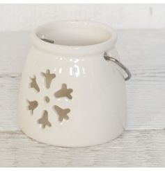 A charming white ceramic t-light holder with snowflake detail for a delicate glow