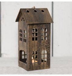 Set with worn down copper walls, this house shaped lantern will bring a delicate glow wherever it goes