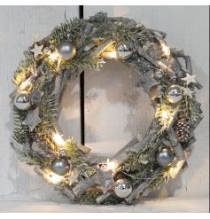 Finished off with silver baubles and warm glowing led lights, this distressed looking  wreath will surly hang with pride