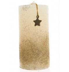 This simple wax pillar candle rolled in a gold and silver glitter topped with a hanging metal star is the perfect way t