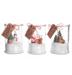 An assortment of 3 was Christmas scene candles