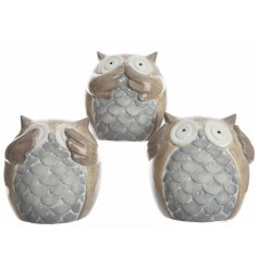 An assortment of 3 owl ornaments in hear/see/speak poses