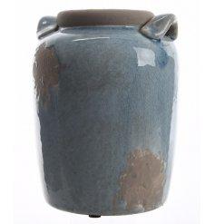 A distressed blue glaze stone vase