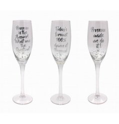 3 quirky silver bubble designed tall flute glasses. Finished with 3 assorted comical prosecco quotes
