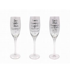 3 quirky silver bubble designed tall flute glasses. Finished with 3 assorted comical champagne quotes