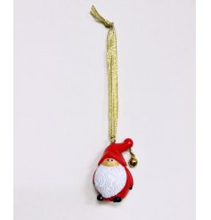 A mini resin santa hanging decoration with bell
