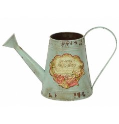 A rustic styled metal watering can finished with its distressed look and 'Flower Garden' front