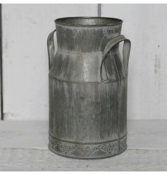 A stylishly distressed vintage zinc churn with a vintage boarder pattern