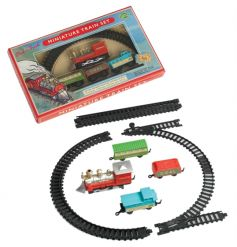 Traditional miniature train set, battery powered miniature locomotive with passenger carriage, waggons and track.