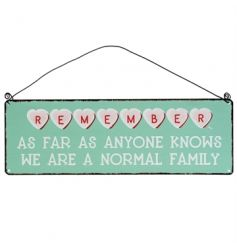"A lovely vintage style metal hanging wall sign that reads.  ""Remember as far as anyone knows we are a normal family."""
