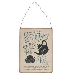 "A vintage style ""everything stops for tea"" metal sign. A great gift item and kitchen accessory."