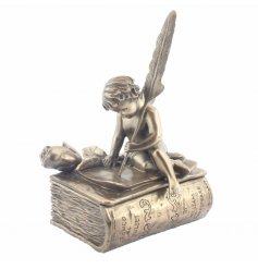 A charming bronze ornament with a cherub sat on a Romeo and Juliet book with a feather and rose.