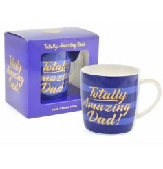 A blue hued china mug with a gold script 'totally amazing dad' quote