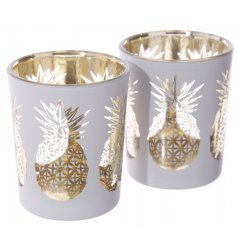 A quirky set of two glass pots, capable of holding either votives or T-lights
