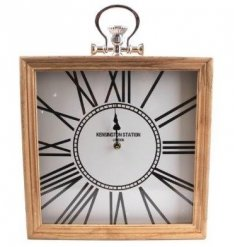 Bring a vintage luxe feel into any home with this stylish natural toned wooden clock