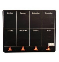 A weekly planner blackboard with copper clips